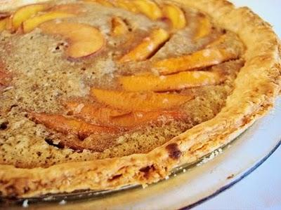 Peach custard pie in a glass pie plate